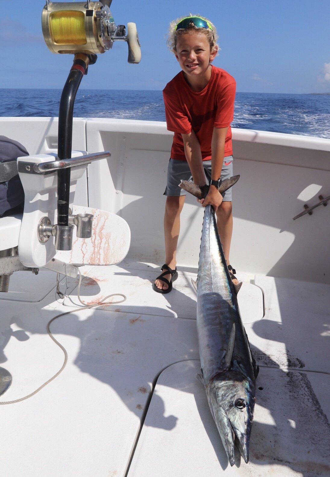 Kid fishing Kona Hawaii